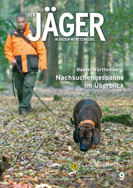 Jaeger im Wald mit Hund